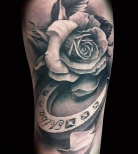 White black rose and horse shoe tattoo