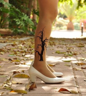 White shoes and tree tattoo on leg