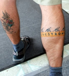 White wings and bicycle tattoo on leg