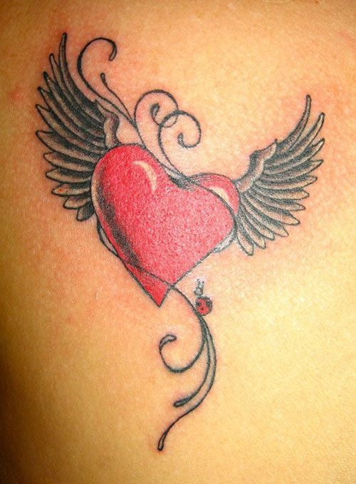 Wings and red heart tattoo