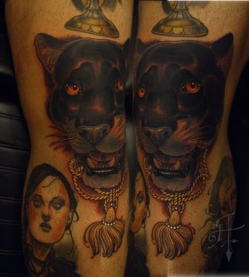 Women and black tiger tattoo on leg