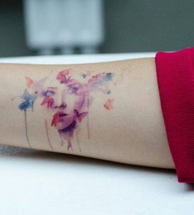Women face and butterfly watercolor tattoo