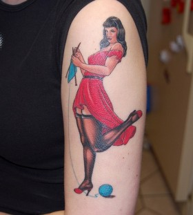 Women with red dress face tattoo on leg