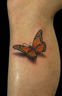 Yellow and black butterfly tattoo on leg