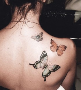 Yellow and black butterfly tattoo on shoulder