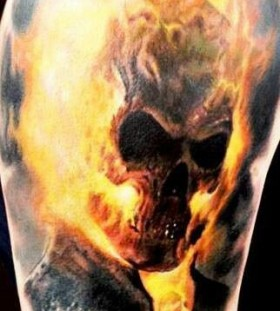 Yellow fire skull tattoo on shoulder