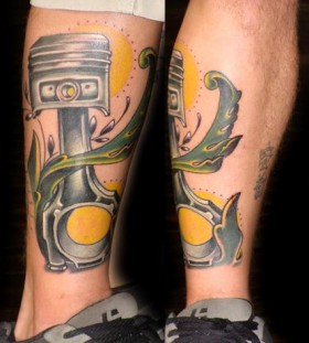 Yellow sun and mechanism of car tattoo on leg