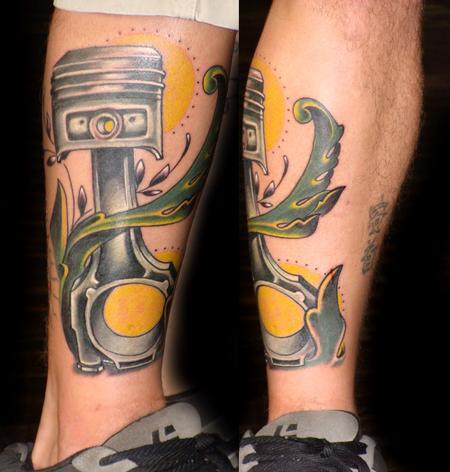 Yellow sun and mechanism of car tattoo on leg