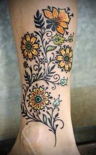Yellow sunflowers flowers tattoo on leg