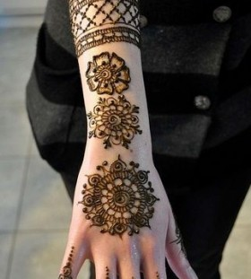 Adorable black Henna and Mehndi design tattoo