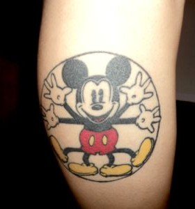 Adorable black and white Mickey Mouse tattoo on leg