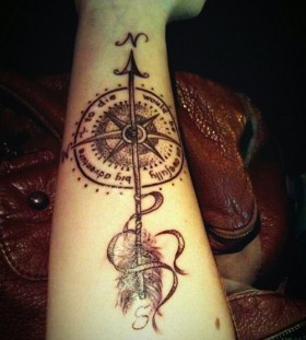 Adorable black compass tattoo on arm