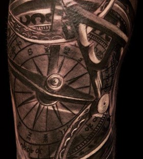 Adorable black lovely compass tattoo on arm