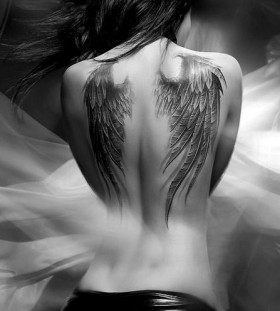 Adorable girl's angel tattoo on shoulder
