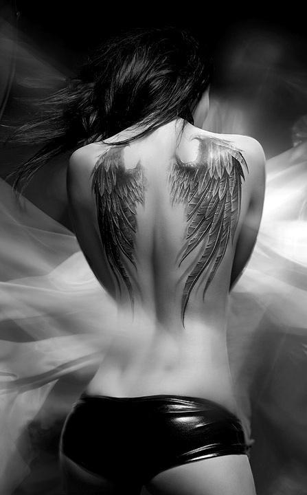 Adorable girl's angel tattoo on shoulder