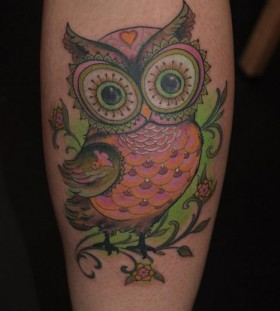 Adorable owl green tattoo