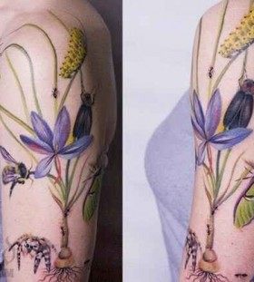 Amazing colorful flowers green tattoo