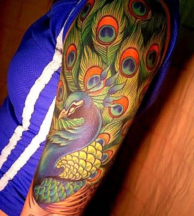 Amazing colors peacock tattoo
