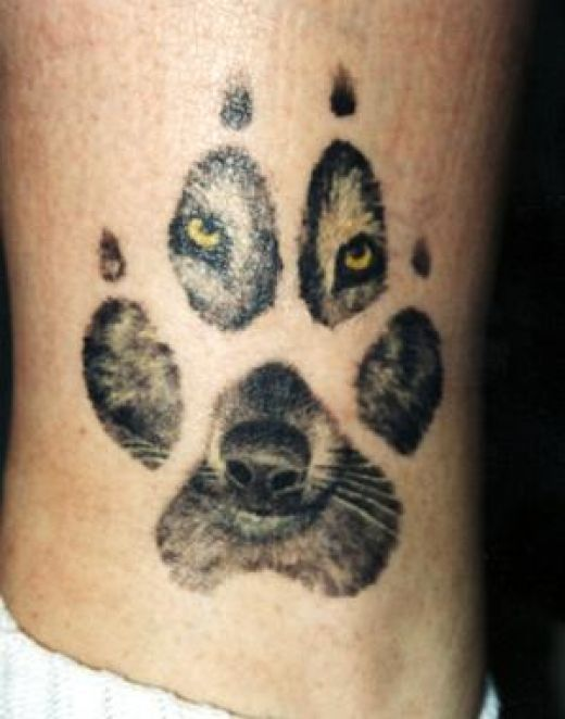 Angry wolf eyes green tattoo
