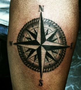 Awesome looking black compass tattoo on arm
