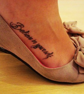 Believe in yourself girl tattoo on foot