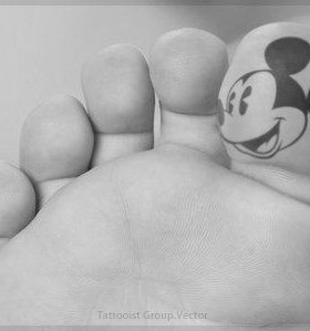 Big finger Mickey Mouse tattoo on leg