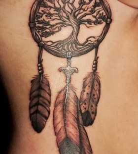 Big tree and dreamcatcher tattoo