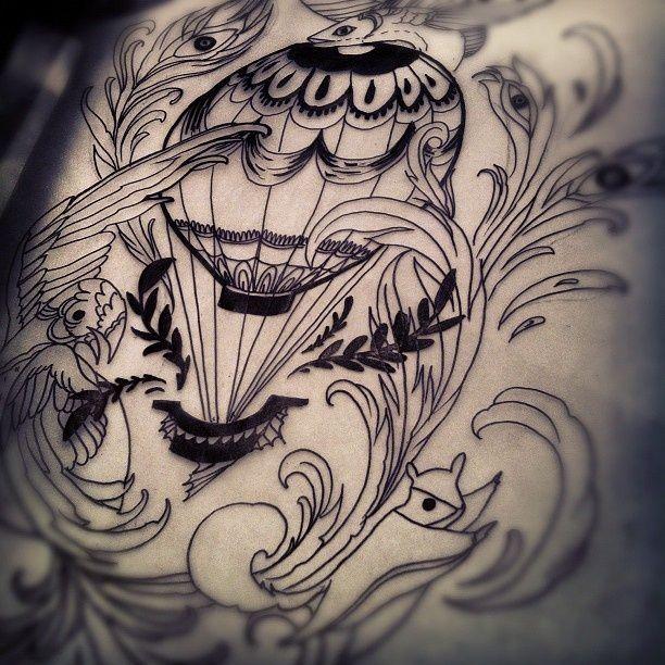 Bird, leafs, eyes and balloon tattoo
