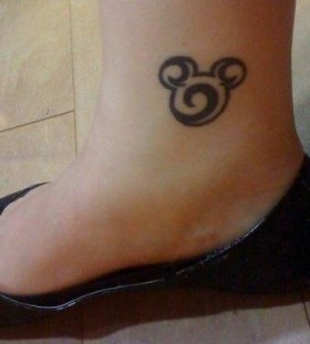 Black adorable Mickey Mouse tattoo on leg