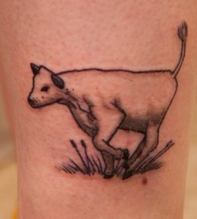 Black adorable cow tattoo