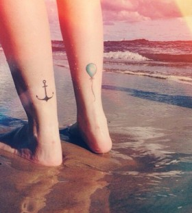 Black anchor, blue balloon tattoo