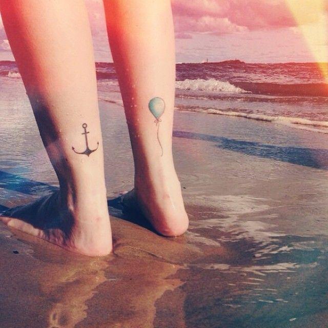 Black anchor, blue balloon tattoo