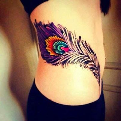 Black and purple girl tattoo on hip