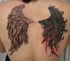 Black and red angel tattoo on shoulder
