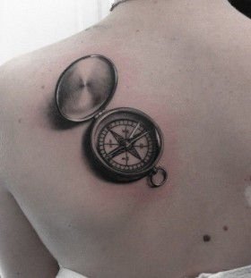 Black gorgeous compass tattoo on back