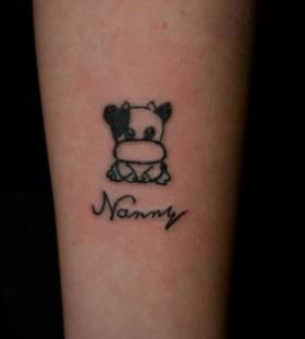 Black gorgeous cow tattoo