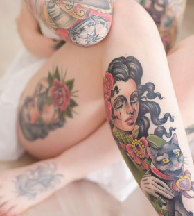 Black hair girl tattoo on leg