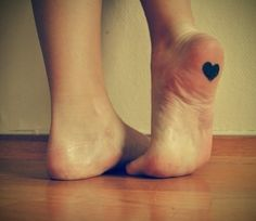 Black heart girl tattoo on foot