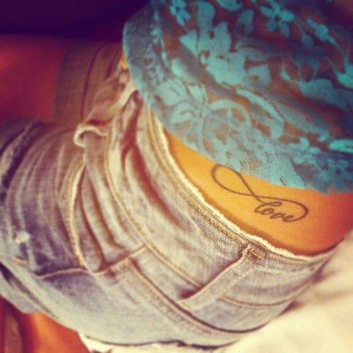 Black love girl tattoo on hip