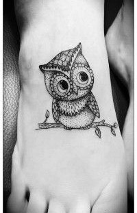 Black owl girl tattoo on foot
