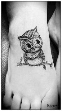Black owl girl tattoo on foot
