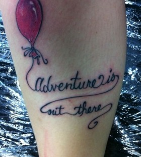Black quote and balloon tattoo
