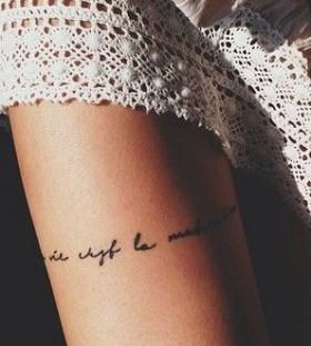 Black quote girl tattoo on leg