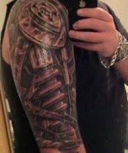 Black shoulder robbot tattoo