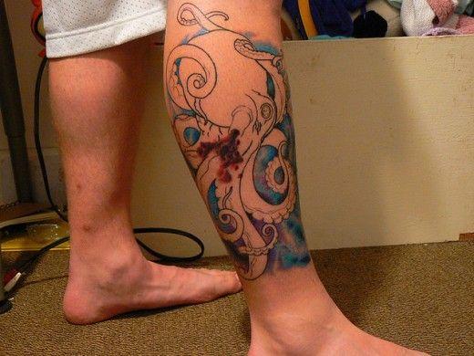 Black simple octopus tattoo on leg
