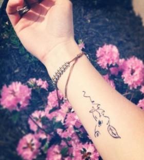 Black wrist cow tattoo