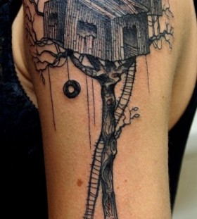 Black's shoulder's house tattoo