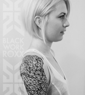 Blonde girl geometric shoulder, back tattoo