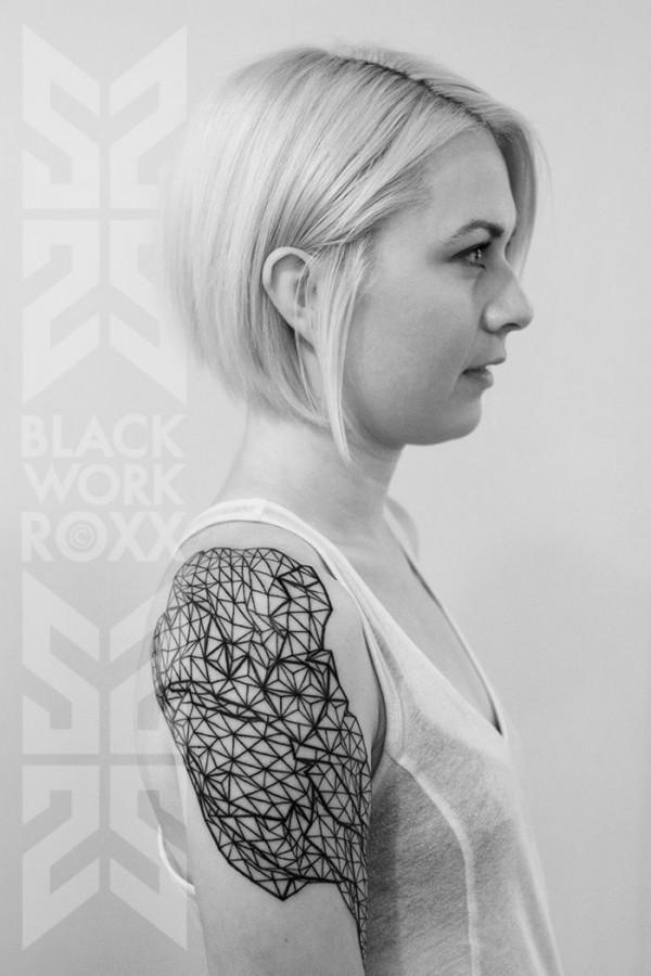 Blonde girl geometric shoulder, back tattoo
