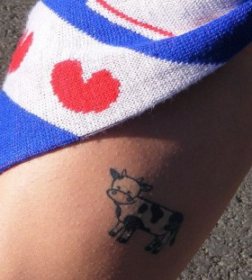 Blue and white cow tattoo
